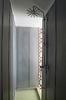 The walk-in shower in the family bathroom is lined with zinc panels ensuring that it is perfectly waterproof