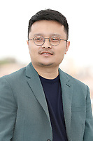 """Gan Bi at the """"Long Day's Journey Into Night (Di Qui Zui Hou De Ye Wan)"""" photocall during the 71st Cannes Film Festival at the Palais des Festivals on May 16, 2018 in Cannes, France. Credit: John Rasimus / Media Punch ***FRANCE, SWEDEN, NORWAY, DENARK, FINLAND, USA, CZECH REPUBLIC, SOUTH AMERICA ONLY***"""