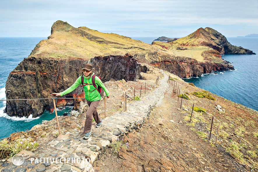 A woman traveler hiking along the coastline of Ponta Sao Lourenco on the island of Madeira