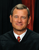Chief Justice John G. Roberts smiles as The Supreme Court Justices of the United States sit for a formal group photo in the East Conference Room of the Supreme Court in Washington on Friday, October 8, 2010.  .Credit: Roger L. Wollenberg - Pool via CNP