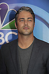 Taylor Kinney - Chicago Fire - NBC Upfront at Radio City, New York City, New York on May 11, 2015 (Photos by Sue Coflin/Max Photos)