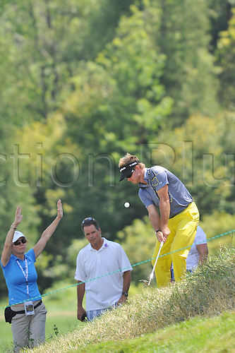 28.07.2012 Brian Gay hits onto the 18th green in the third round of the RBC Canadian Open at the Hamilton Golf and Country Club in Ancaster, Ontario.