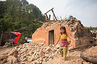 Sandha, 9, plays in front of her destroyed house at Dhulikhel, near Kathmandu, Nepal. May 8, 2015
