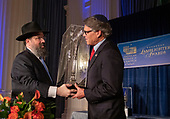 United States Secretary of Energy Rick Perry, right, accepts the 2019 Lamplighter Public Service Award from Rabbi Levi Shemtov, Executive Vice President of the American Friends of Lubavitch (Chabad), left. during a gala dinner at the Organization of American States in Washington, DC on Tuesday, June 18, 2019.<br /> Credit: Ron Sachs / CNP