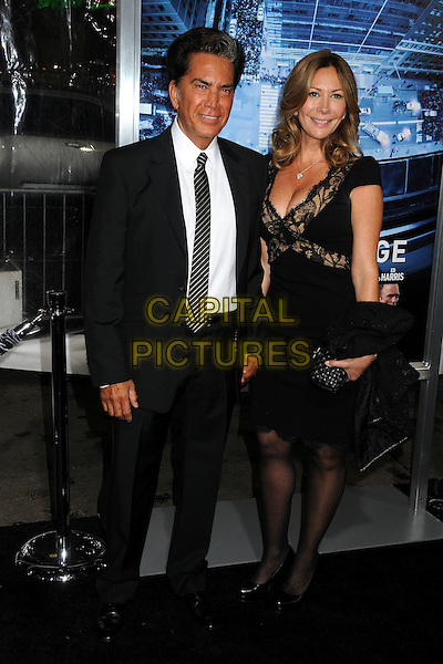 Jose Luis Rodrguez (aka El Puma) & guest.L.A. Premiere of 'Man on a Ledge' held at The Grauman's Chinese Theatre in Hollywood, California, USA..January 23rd, 2012.full length black white suit shirt tie dress.CAP/ADM/BP.©Byron Purvis/AdMedia/Capital Pictures.