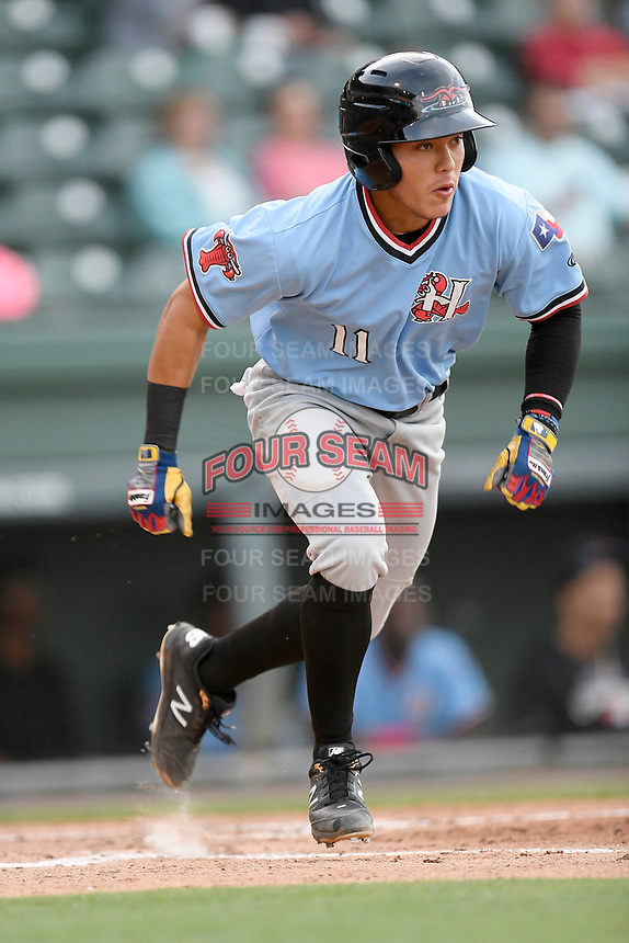 Shortstop Frainyer Chavez (11) of the Hickory Crawdads runs out a batted ball in a game against the Greenville Drive on Wednesday, May 15, 2019, at Fluor Field at the West End in Greenville, South Carolina. Greenville won, 6-5. (Tom Priddy/Four Seam Images)