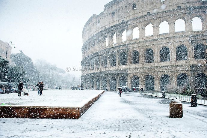 Snow falling over the Colosseum in Rome, Italy