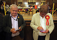 Pictured: Labour representatives checking notes. Friday 09 June 2017<br /> Re: Counting of ballots at Brangwyn Hall for the general election in Swansea, Wales, UK
