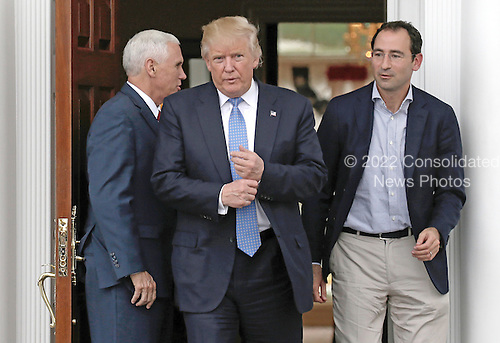 United States President-elect Donald Trump (C) and Vice President-elect Mike Pence (L) exit after meeting with Jonathan Gray (R) at the clubhouse of Trump International Golf Club, in Bedminster Township, New Jersey, USA, 20 November 2016.<br /> Credit: Peter Foley / Pool via CNP