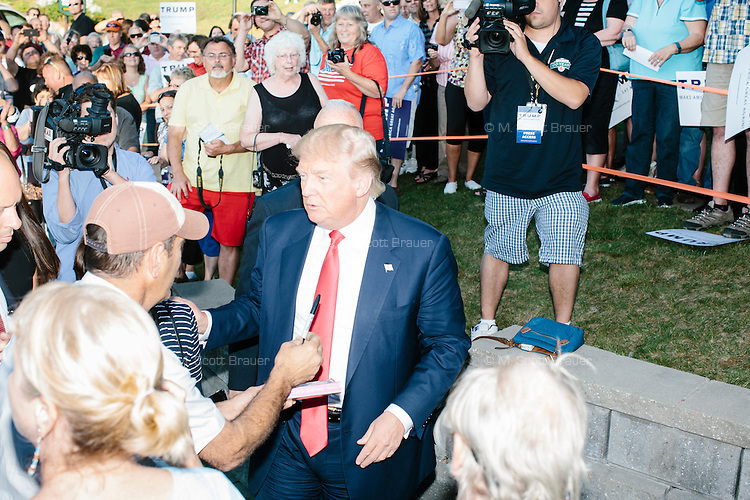 Real estate mogul and Republican presidential candidate Donald Trump greets supporters before speaking at a rally at the Weirs Beach Community Center in Laconia, New Hampshire.