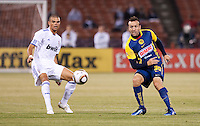 Pepe (left) watches the ball against Matias Vuoso (right). Real Madrid defeated Club America 3-2 at Candlestick Park in San Francisco, California on August 4th, 2010.