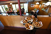 NWA Democrat-Gazette/J.T. WAMPLER Rayna Warrix hustled a tray of food to a table at the Restaurant on the Corner in Fayetteville Wednesday May 17, 2017. The restaurant has been sold and its future is uncertain.