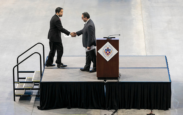A. Gabriel Esteban, Ph.D., president of DePaul University, takes to the stage after being introduced by Bamshad Mobasher, president of the faculty council. Dr. Esteban presented his State of the University address to faculty and staff members, Friday, Sept. 15, 2017, at the Wintrust Arena, where he outlined the current climate of higher education, student enrollment and the strategic planning process. (DePaul University/Jamie Moncrief)