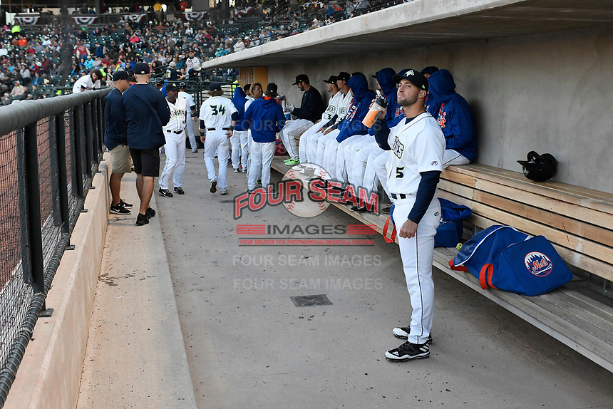 Left fielder Tim Tebow (15) of the Columbia Fireflies watched play in between innings of his first Class A game against the Augusta GreenJackets on Opening Day, Thursday, April 6, 2017, at Spirit Communications Park in Columbia, South Carolina. (Tom Priddy/Four Seam Images)