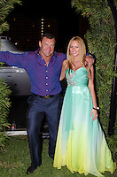 Couple outside yacht at 2013 Hearts & Stars Gala at Tierra Veritatis, Miami Beach, FL, March 9, 2013