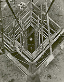Colonel Charles A. Lindbergh took this picture of Doctor Robert H. Goddard's rocket looking down the launching tower on September 23, 1935 in Roswell, New Mexico. In 1935 Goddard launched the A-series of tests on rockets made with gyro- controlled blast vane, which stabilized the rocket during flight. Doctor Goddard has been recognized as the father of American rocketry and as one of the pioneers in the theoretical exploration of space. His dream was the conquest of the upper atmosphere and ultimately space through the use of rocket propulsion. When the United States began to prepare for the conquest of space in the 1950's, American rocket scientists began to recognize the debt owed to the New England professor. They discovered that it was virtually impossible to construct a rocket launch a satellite without acknowledging the work of Doctor Goddard. .Credit: NASA via CNP