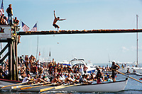 Competitors participate in the Greasy Pole Contest during St. Peter's Fiesta in Gloucester, Massachusetts, USA.