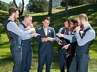 Groomsman admire the wedding ring