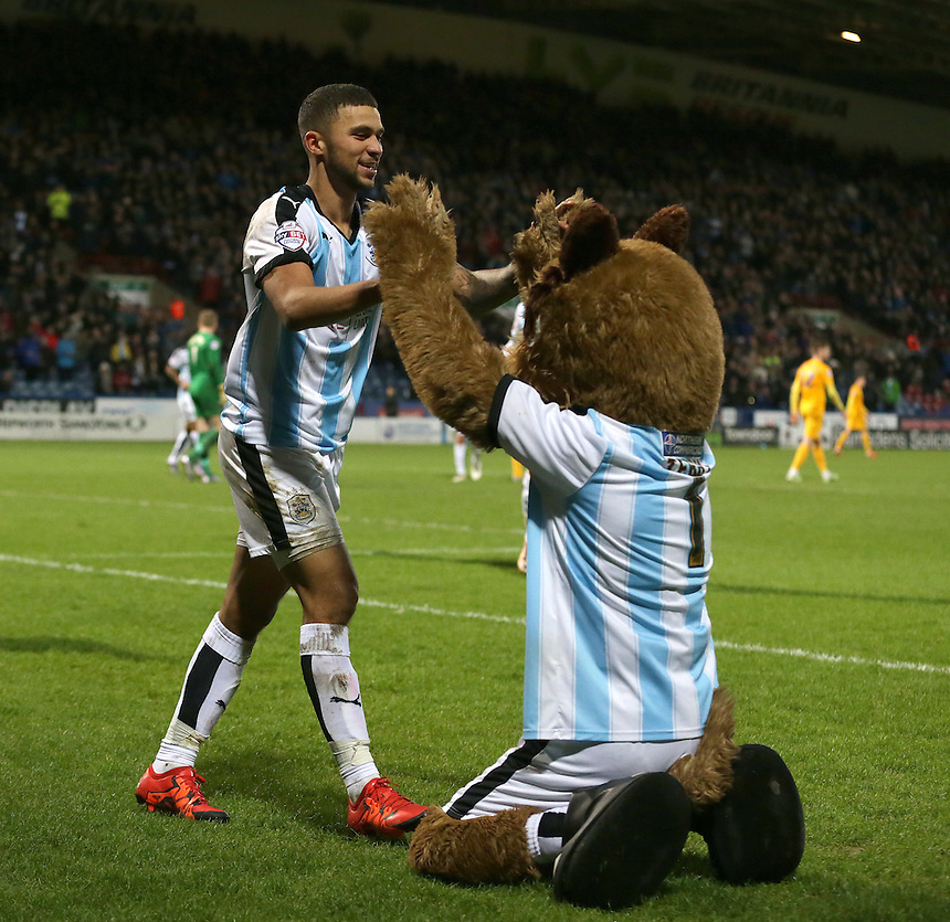 Huddersfield Town's Nahki Wells celebrates scoring his sides second goal with team mascot Terry the Terrier<br /> <br /> Photographer Stephen White/CameraSport<br /> <br /> Football - The Football League Sky Bet Championship - Huddersfield Town v Preston North End - Saturday 26th December 2015 - The John Smith's Stadium - Huddersfield<br /> <br /> &copy; CameraSport - 43 Linden Ave. Countesthorpe. Leicester. England. LE8 5PG - Tel: +44 (0) 116 277 4147 - admin@camerasport.com - www.camerasport.com
