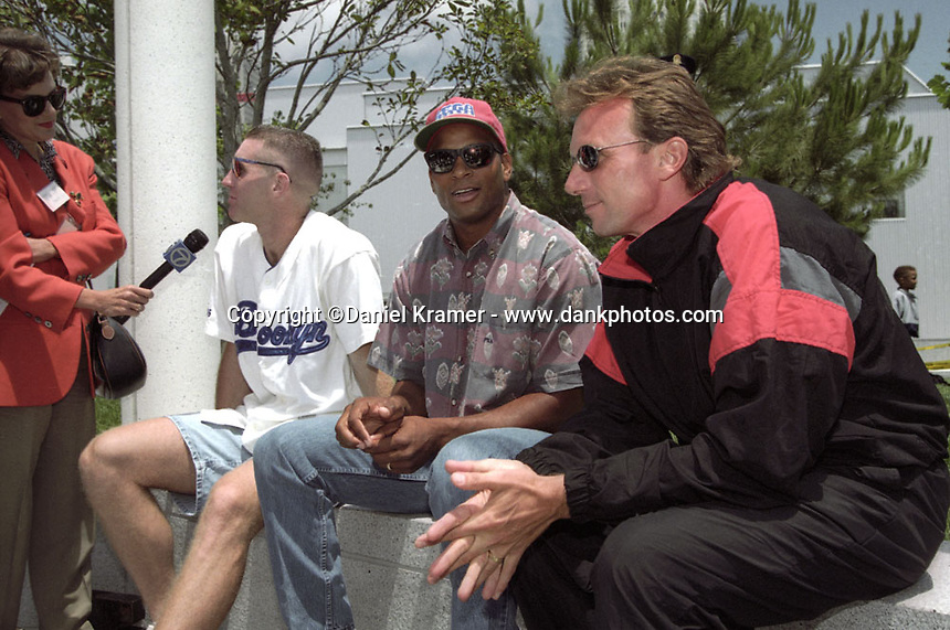 From left, NBA player and Olympic Dream Team member Chris Mullin is interview while former San Francisco 49ers running back Roger Craig and quarterback Joe Montana look on at a charity event in San Francisco in the mid 1990s.