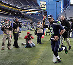 Seattle Seahawks  quarterback Russell Wilson departs the field after defeating the Minnesota Vikings at CenturyLink Field in Seattle, Washington on  November 17, 2013.  The Seahawks beat the Vikings 41-20.  ©2013.  Jim Bryant. All Rights Reserved.