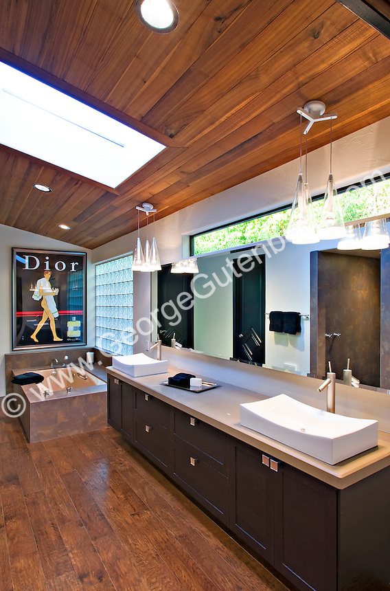 Beautiful wood floor and ceiling are seen in luxurious modern master bath Stock photo of master bath, en suite, bathroom