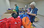 Sally Lloyd (left) and Sister Jo Murray assemble backpacks and bags of personal items for women and children who've been released from immigration detention facilities in Texas. The women have fled violence in Central America with their children and were detained by immigration authorities upon their arrival in the United States. After being released in San Antonio, they travel onward to stay with relatives elsewhere in the U.S., pending a final decision on their request for asylum. <br /> <br /> The backpacks and bags are assembled at El Divino Salvador United Methodist Church in San Antonio. The project is sponsored by the Interfaith Welcome Coalition. Lloyd is a member of University Presbyterian Church. Murray, a Roman Catholic, is a member of the Holy Spirit Sisters.