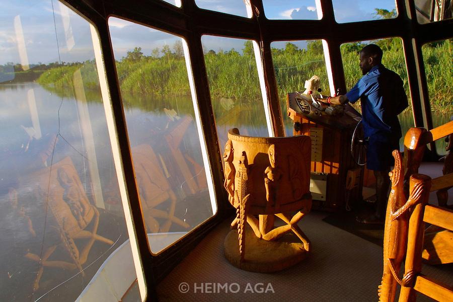 East Sepik Province. Karawari River. The Sepik Spirit cruise vessel. Captain's Bridge sporting ornate woodcarvings.