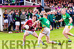 Dromids Criostóir Ó Fairrcheallaigh runs out of options as Skelligh Rangers Gerard O'Sullivan & Bernard Walsh close in.