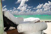 Ile au Cerfs, Mauritius. White towels on sun lounger with a tourquoise sea.
