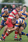 S. Tangi & B. Arthur tackle a strong running H. Liu. Counties Manukau Rugby Union Premier round 7  game between Patumahoe & Karaka played at Patumahoe on May 26th 2007. Karaka led 5 - 3 at halftime and went on to win 12 - 3.