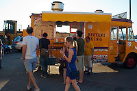 Patron queue up at the Desi Truck, serving Indian food, at a festival in Staten Island in New York on Saturday, June 23, 2012. (© Richard B. Levine)