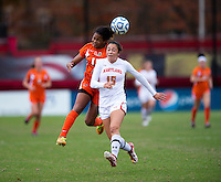 Erika Nelson (15) of Maryland collides on a header with Jasmine Paterson (15) of Miami during the game at Ludwig Field in College Park, MD.  Maryland defeated Miami, 2-1, in overtime.