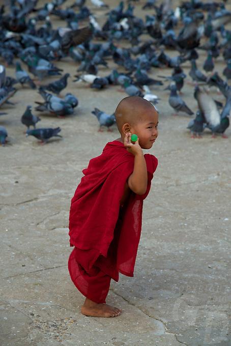 A very playful Novice Monk at Shwezigon Pagoda, Bagan, Myanmar, Burma.