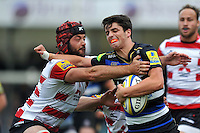 Adam Hastings of Bath Rugby looks to fend Gareth Evans of Gloucester Rugby. West Country Challenge Cup match, between Gloucester Rugby and Bath Rugby on September 13, 2015 at the Memorial Stadium in Bristol, England. Photo by: Patrick Khachfe / Onside Images
