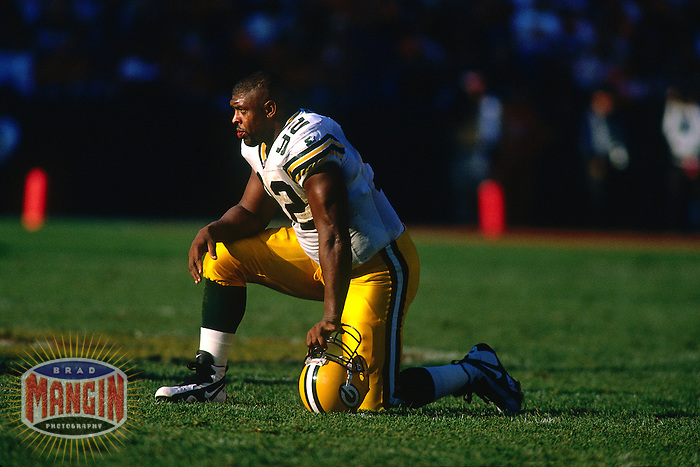 SAN FRANCISCO, CA - Reggie White of the Green Bay Packers rests during a break in the action during a game against the San Francisco 49ers at Candlestick Park in San Francisco, California in 1995. Photo by Brad Mangin