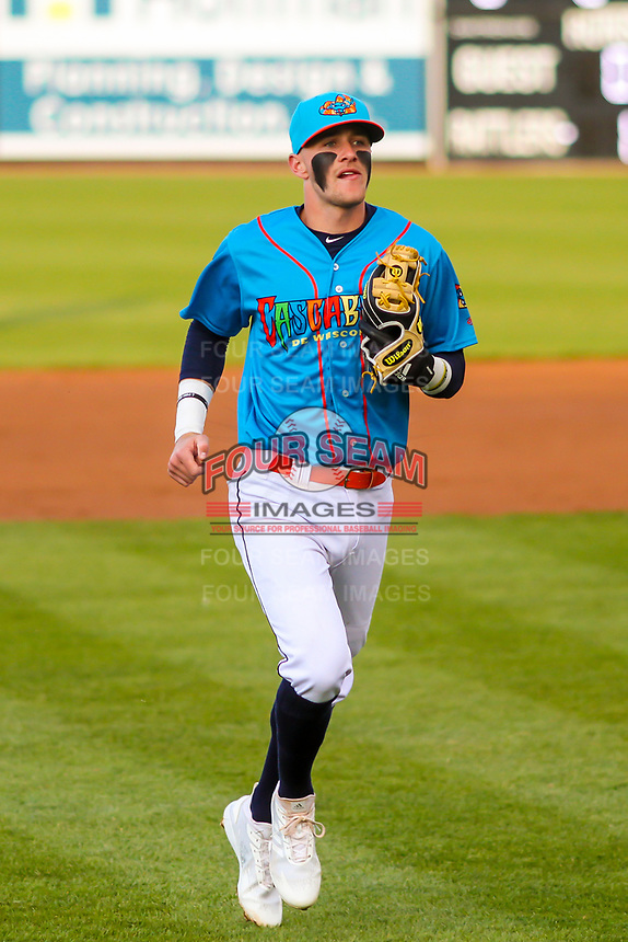 Wisconsin Timber Rattlers second baseman Brice Turang (2) jogs to the dugout between innings during a Midwest League game against the Lake County Captains on May 10, 2019 at Fox Cities Stadium in Appleton, Wisconsin. Wisconsin defeated Lake County 5-4. (Brad Krause/Four Seam Images)