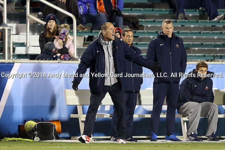 12 December 2014: Virginia head coach George Gelnovatch urges his team on. The University of Virginia Cavaliers played the University of Maryland Baltimore County Retrievers at WakeMed Stadium in Cary, North Carolina in a 2014 NCAA Division I Men's College Cup semifinal match.