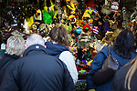 © Joel Goodman - 07973 332324 . 21 November 2013 . Manchester , UK . People look at a puppet stall . Candid photos of the Christmas Markets in Manchester City Centre . Photo credit : Joel Goodman
