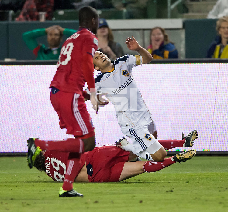 CARSON, CA – July 9, 2011: LA Galaxy midfielder Landon Donovan (10) is fouled by Chicago FIre forward Diego Chaves (99) during the match between LA Galaxy and Chicago Fire at the Home Depot Center in Carson, California. Final score LA Galaxy 2, Chicago Fire FC 1.