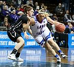 SIOUX FALLS, SD - MARCH 19: Caitlyn Cunyus #2 from Lubbock Christian drives against Kelsey Williams #13 from Central Missouri during their quarterfinal game at the 2018 Elite Eight Women's NCAA DII Basketball Championship at the Sanford Pentagon in Sioux Falls, SD. (Photo by Dave Eggen/Inertia)