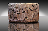 Picture of Neo-Hittite orthostat describing the legend of Gilgamesh from Karkamis,, Turkey. Museum of Anatolian Civilisations, Ankara. Mythological scene. The 2 figures in the center are flanked by lion headed men who have one fist outstretched and are known as Ugallu. The 2 figures in the middle holding spears are men with bodies of bulls known as Kusarikku. 1