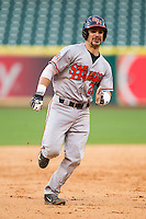 Anthony Azar #20 of the Sam Houston State Bearkats legs out a triple against the Texas Christian Horned Frogs at Minute Maid Park on February 28, 2014 in Houston, Texas.  The Bearkats defeated the Horned Frogs 9-4.  (Brian Westerholt/Four Seam Images)