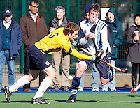Alex Collins (R) of Hampstead finds his path blocked by Ali Bray during the England Hockey League Mens Cup Quarter Final game between Hampstead & Westminster and Old Loughtonians at Paddington Rec, Maida Vale on Sun Mar 7, 2010