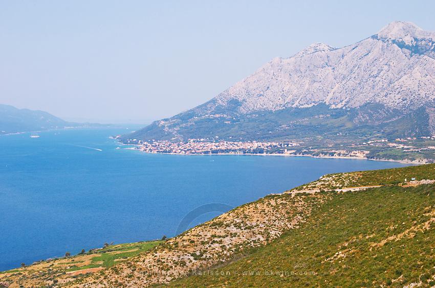 View over the Orebic village town and the Sveti Ilija mountain, dark blue sea towards Korculanski Kanal Peljesac Peninsula. Orebic town. Peljesac peninsula. Dalmatian Coast, Croatia, Europe.