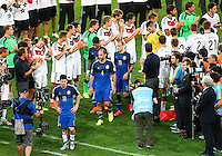 Germany players form a tunnel as they applaud the Argentina team as they go to collect their runners up medals