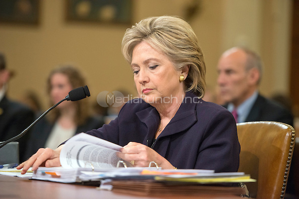 Former United States Secretary of State Hillary Rodham Clinton, a candidate for the 2016 Democratic Party nomination for President of the United States, looks over her notes prior to giving testimony before the US House Select Committee on Benghazi on Capitol Hill in Washington, DC on Thursday, October 22, 2015.<br /> Credit: Ron Sachs / CNP/MediaPunch
