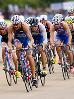 15 SEP 2013 - LONDON, GBR - Aurelien Raphael (FRA) (centre) of France drafts Alessandro Fabian (ITA) (second from the left) of Italy on the bike during the elite men's ITU 2013 World Triathlon Series Grand Final in Hyde Park, London, Great Britain (PHOTO COPYRIGHT © 2013 NIGEL FARROW, ALL RIGHTS RESERVED)