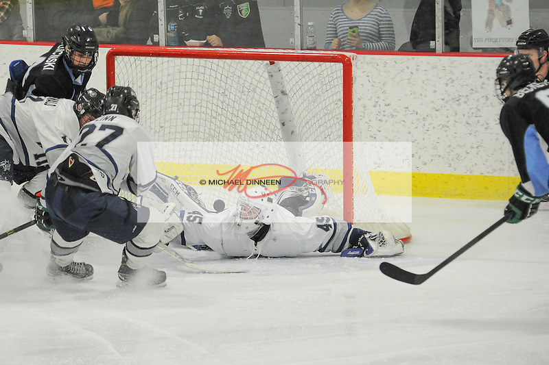 Eagle River goalie Ryan Gray sprawls to make a save as Chugiak's Zach Plucinski and Andrew Beckett converge during the Mustangs' 7-1 win at the McDonald Center, Friday, Dec. 16, 2016.  Photo by Michael Dinneen for the Star