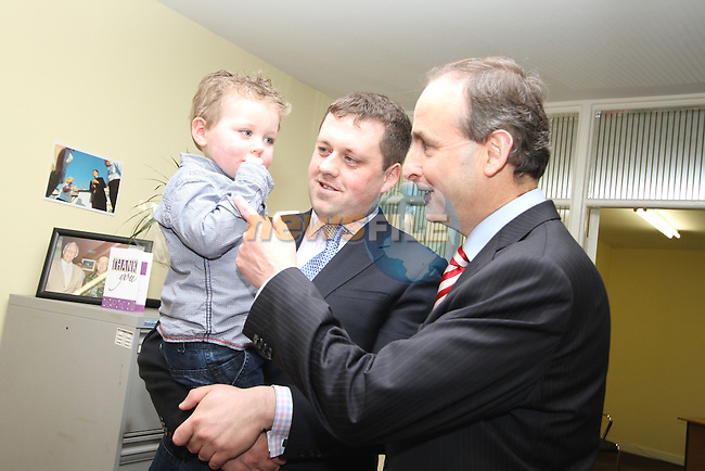 Micheál Martin with Thomas Byrne and son, Thomás at Fianna Fail Rally Kells...(Photo credit should read Jenny Matthews www.newsfile.ie)....This Picture has been sent you under the conditions enclosed by:.Newsfile Ltd..The Studio,.Millmount Abbey,.Drogheda,.Co Meath..Ireland..Tel: +353(0)41-9871240.Fax: +353(0)41-9871260.GSM: +353(0)86-2500958.email: pictures@newsfile.ie.www.newsfile.ie.